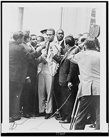 MalcolmX with Reporters